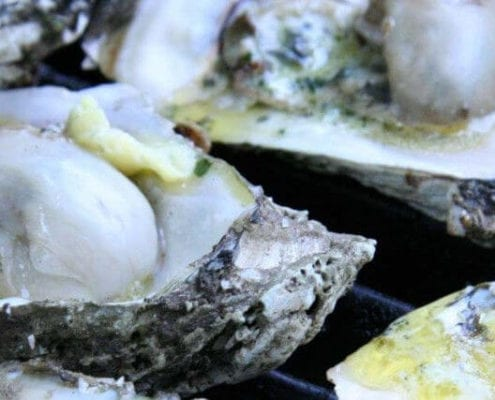 Grilled Oysters with Roasted Garlic